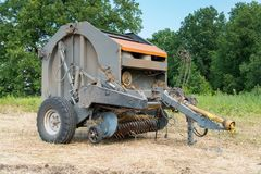 Press baler for collecting hay in rolls. Agricultural machinery. Press baler for collecting hay in rolls stock photos