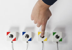 Press the button with finger, on white background Stock Photos