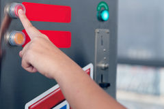 Press the button service to the coins machine.  Royalty Free Stock Photos