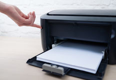 Press the button to enable or disable  printer. Press the button to enable or disable the printer Stock Photo