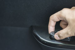 Press the button to open or close the car door. Stock Photo