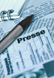 Press-card, blue version. Press card with pen, notepad and part of newspaper Royalty Free Stock Photos