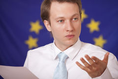 Press conference. Man answering to questions in front of european union flag royalty free stock photo