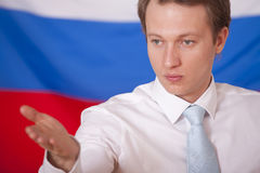 Press conference. Man over russian flag answering to questions by press conference royalty free stock photo