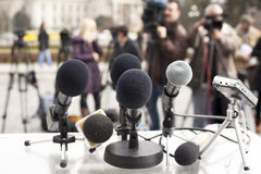 Press conference. Microphones at a press conference Stock Photos