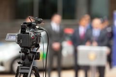 Press conference. Covering an event with a video camera. Stock Photography