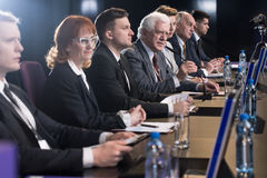 Press conference in full. Politicians fighting for voters during press conference stock photo