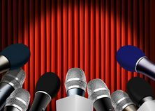 Press conference with microphone. Over red curtain Royalty Free Stock Photography