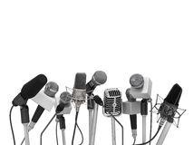Press conference with standing microphones. Royalty Free Stock Photo