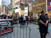 Press Conference in Times Square, Talking to the News Media, NYC, USA. Police officers guard Manhattan Councilman Ydanis Rodríguez, Senator for the New York Royalty Free Stock Images