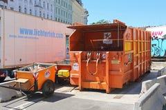 Press Container. VIENNA, AUSTRIA - JULY 11: Press Container Compactor in Wien on JULY 11, 2015. Big Industrial Waste Disposal Hydraulic Bin at Naschmarkt in Stock Image