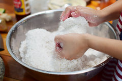 Press cream out of the coconut meat. Hands press cream out of the coconut meat into the bowl stock image