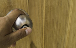 Press the door lock knobs . Royalty Free Stock Images