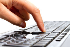 Press enter button. Female finger pressing enter button on the keyboard royalty free stock images