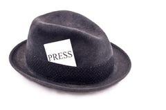 press för hattjournalistfoto Arkivbild