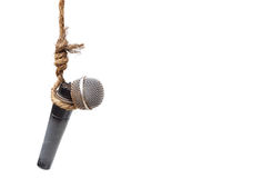 Press freedom. Broken microphone hung on a rope - Threatening press freedom concept Royalty Free Stock Images