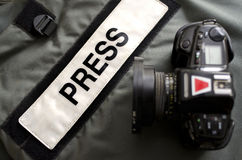 Press Gear Studio. Press photographers bullet proof vest and professional camera Stock Photos