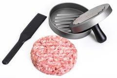 Press hamburger and minced. Studio Photo royalty free stock image