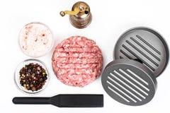 Press hamburger and minced. Studio Photo royalty free stock photography