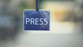 Press identification card against blurred background, privilege pass for media. Stock footage stock video