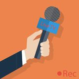 Press illustration. Microphone in hand. The Royalty Free Stock Photo