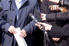 News conference. Media interview. Public relations - PR. Press interview. Broadcast journalism. Microphone Stock Images