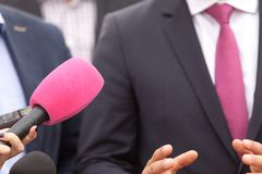 Public relations - PR. Media interview. Press conference. Press interview. Broadcast journalism. Microphone Stock Photos