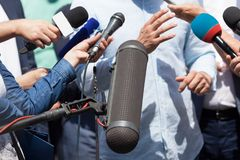 Public relations - PR. Media interview. News conference. Press interview. Broadcast journalism. Microphones Stock Photo