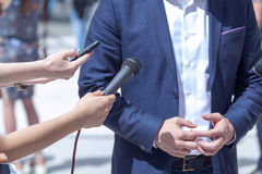 Press interview with businessperson, spokesperson or politician. Media interview with businessman, spokesman or politician Stock Image
