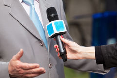 Press interview. Microphone. Journalism. Royalty Free Stock Photo