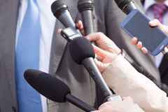 Press interview. News conference. Royalty Free Stock Images