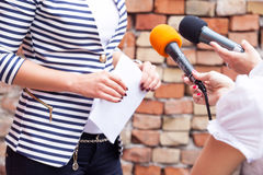 Press interview. News conference. Microphones. Royalty Free Stock Image