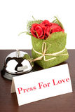 Press for Love Sign at Hotel. Service Bell with Press Fore Love Sign and red roses at Hotel Desk Royalty Free Stock Images
