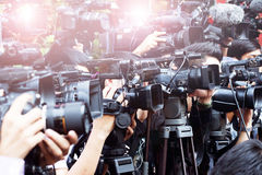 Press and media camera ,video photographer on duty in public new Stock Photography
