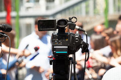 Press or news conference. Filming media event with a video camer. Covering an press event with a video camera. Media interview Stock Images
