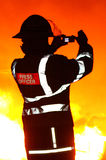 Press officer fireman with camera at fire Stock Photos