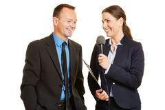 Press officer giving interview to journalist Royalty Free Stock Photos