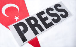 Press panel of journalists lying on the Turkish flag. press freedom in Turkey. Royalty Free Stock Images