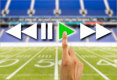 Press play button in football rugby. Hand pressed to play video the football rugby american play online royalty free stock image
