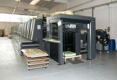 Press printing - Offset machine. Offset press is a printing machine designed to produce fine quality reproductions. Offset printing is a widely used printing stock images