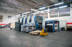 Press printing - Offset machine. Offset press is a printing machine designed to produce fine quality reproductions. Offset printing is a widely used printing stock photography