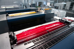 Press printing - Offset machine (detail Ink). Offset press is a printing machine designed to produce fine quality reproductions. Offset printing is a widely used stock photo