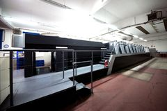 Press printing - Offset machine. Printing technique where the inked image is transferred from a plate to a rubber blanket, then to stock photography