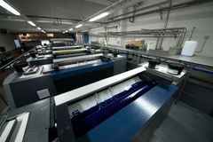 Press printing - Offset machine. Printing technique where the inked image is transferred from a plate to a rubber blanket, then to royalty free stock photos