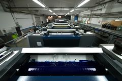 Press printing - Offset machine. Printing technique where the inked image is transferred from a plate to a rubber blanket, then to stock photos