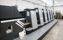 Press printing (printshop) - Offset. Offset press is a printing machine designed to produce fine quality reproductions. Offset printing is a widely used printing royalty free stock images