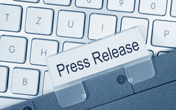Press Release - folder with text on computer keyboard. In the office Stock Image