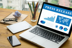 Press Release. Laptop on table. Warm tone Stock Images