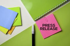 Press Release text on top view office desk table of Business workplace and business objects stock image