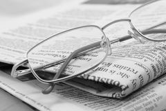 Press review. Glasses and newspapers. Press review Royalty Free Stock Photo